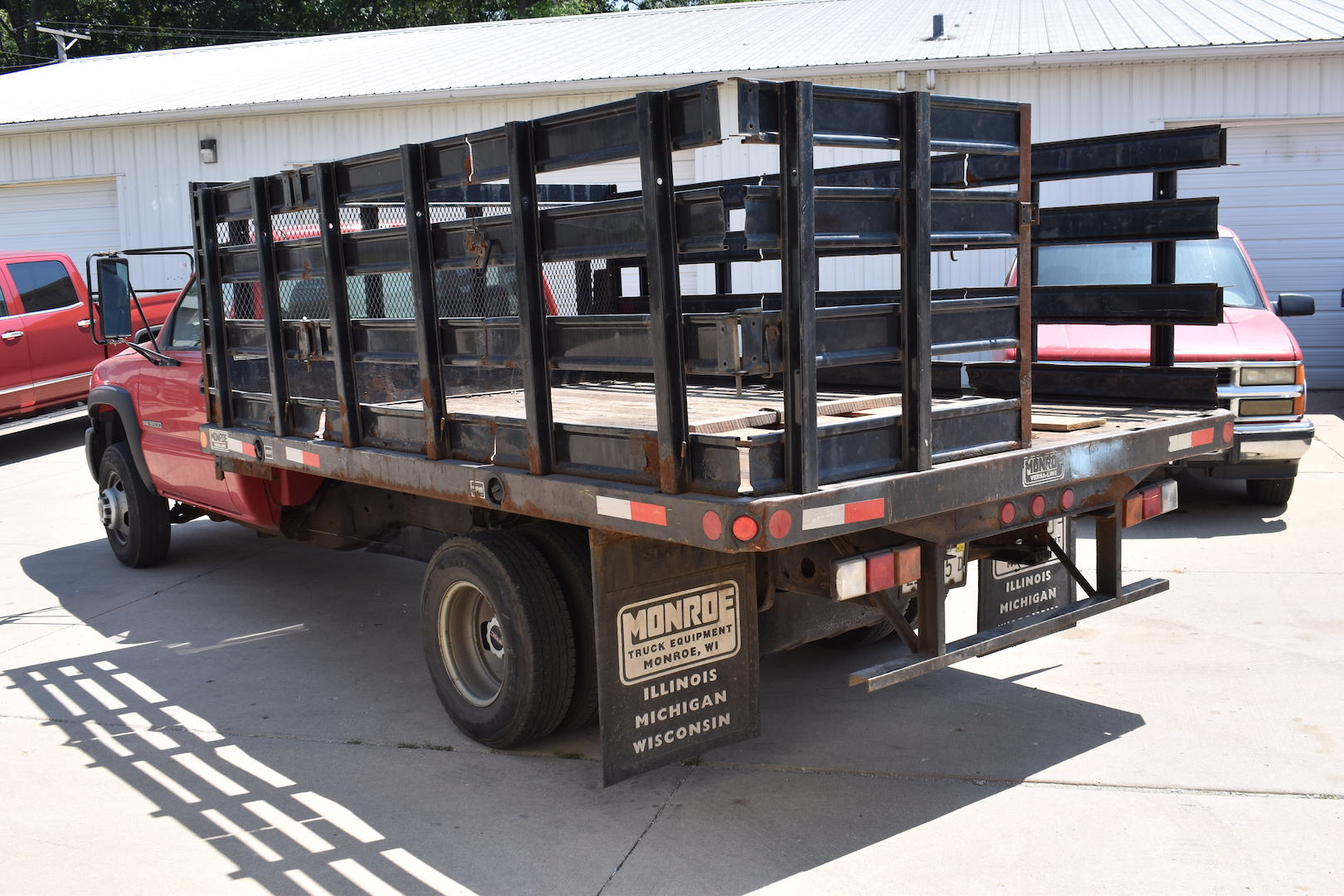 Lot 63 - 2005 GMC 3500 Single-Axle Stake Bed Truck, VIN 1GDJC34UX5E344645, 12 ft. (approx.) Bed, Vortec 6.
