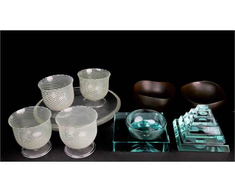Two Venini amber glass bowls, 14.5 cm wide, together with a set of four Italian glass pedestal glasses of swirl design, a sim