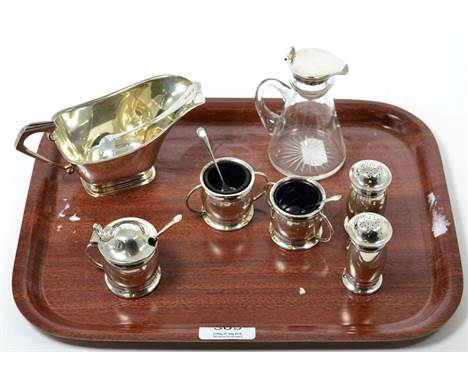 A silver sauce boat and ladle; a silver mounted whisky noggin and a five piece condiment set