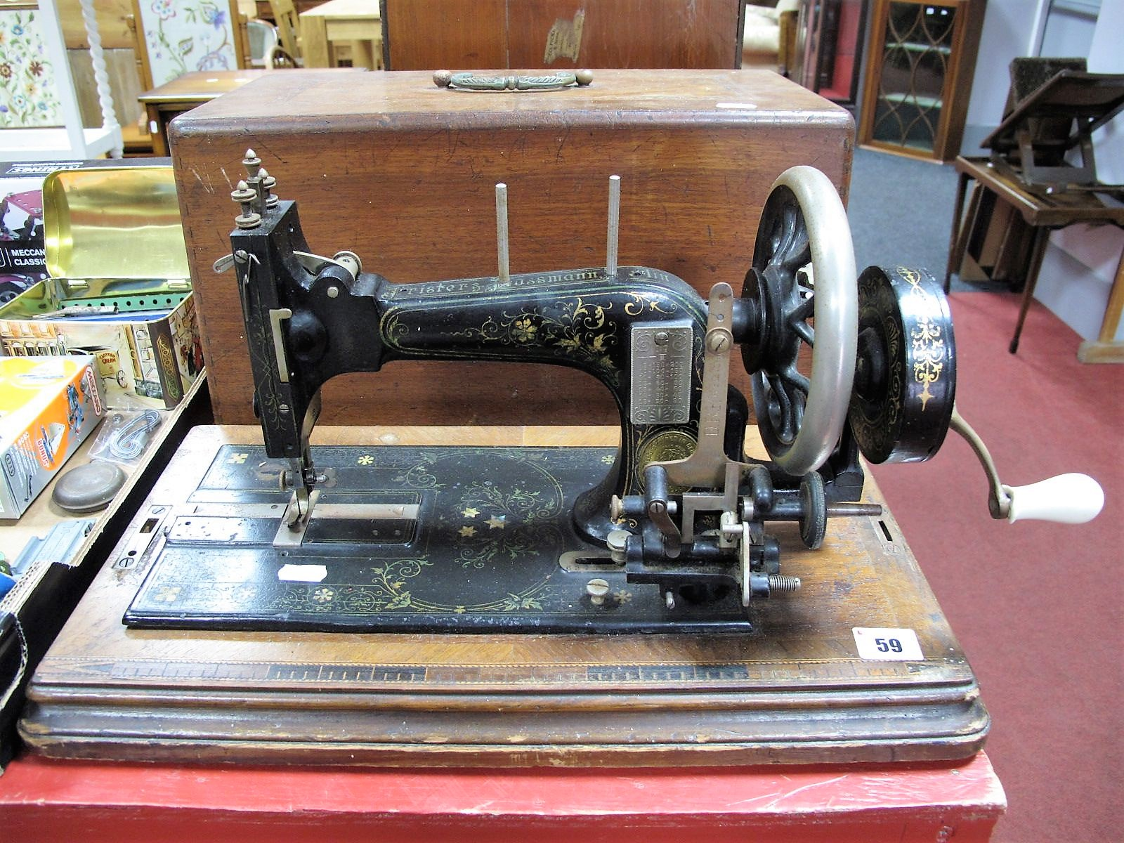 """Lot 59 - An Early XX Century """"Frister and Rossman"""" of Berlin, Germany, Mahogany Cased Sewing Machine."""