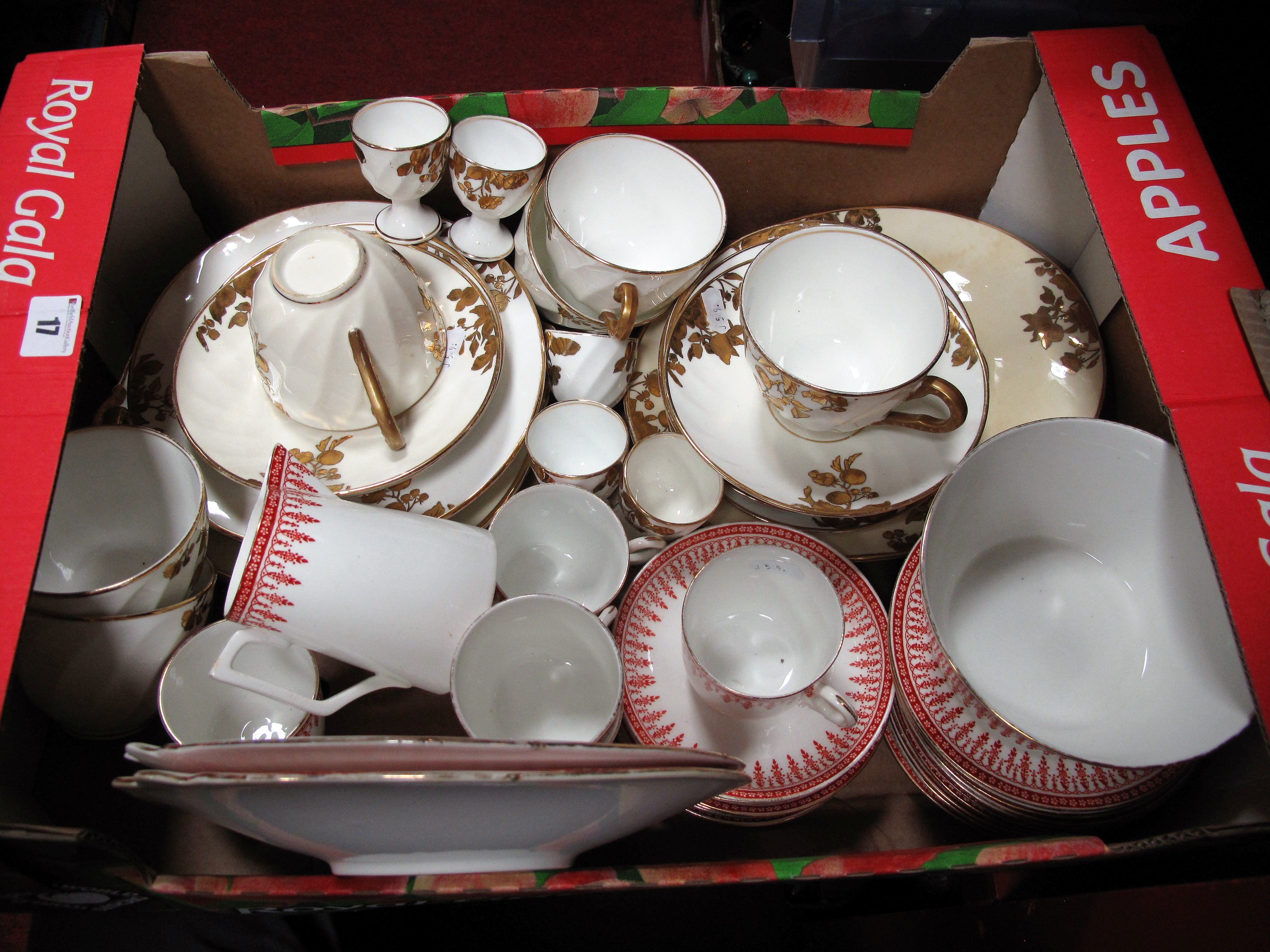 "Lot 17 - An Early XX Century China Tea Service, with foliate decoration, ""Rhine, England"" printed on base,"