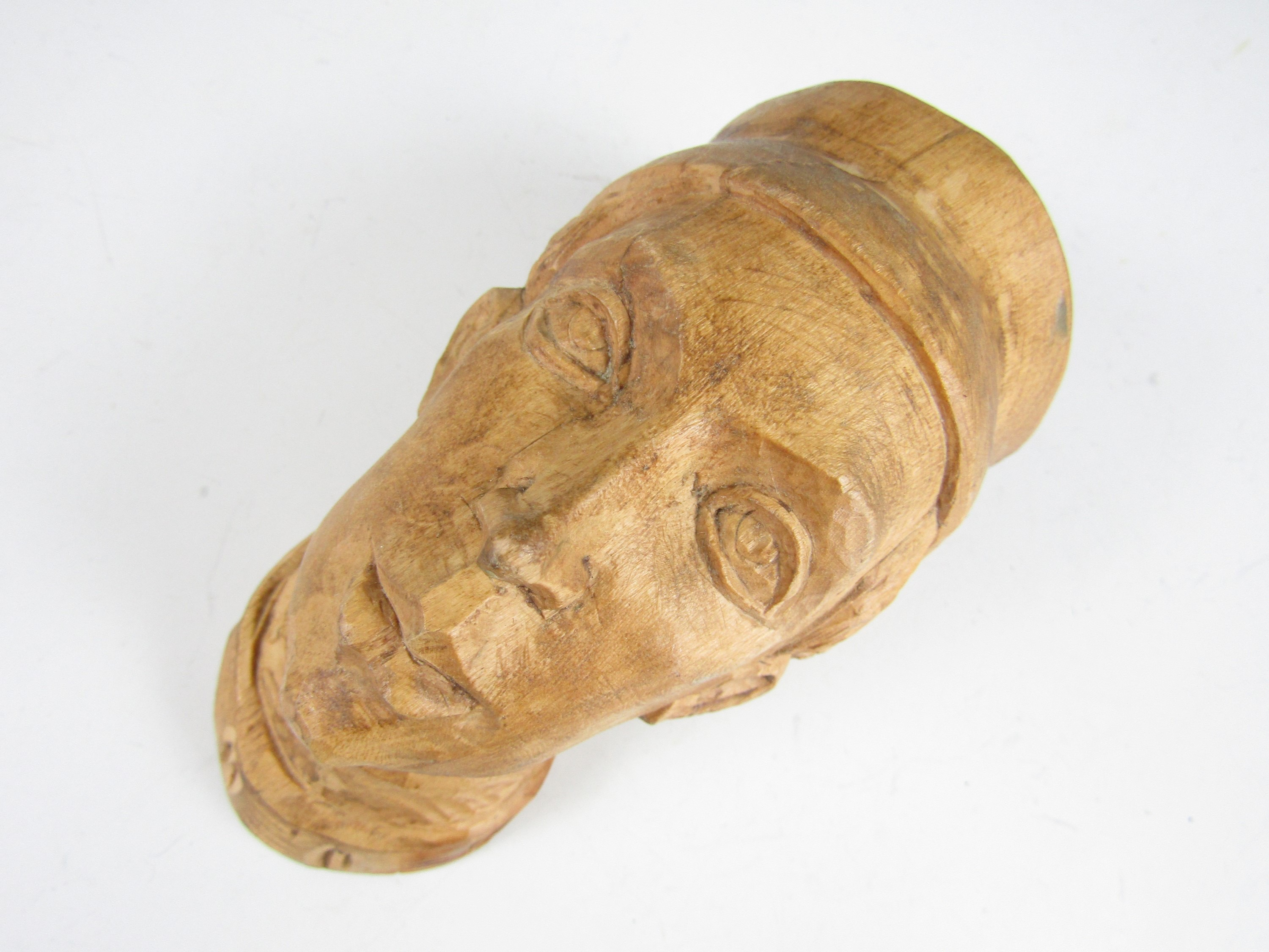 Lot 26 - A carved wooden head, the reverse carved H S Krakow, 16 cm