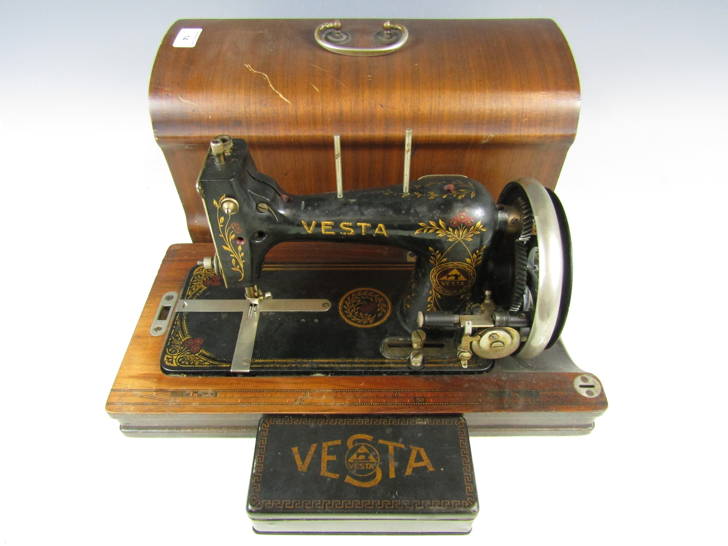Lot 14 - An early 20th Century Vesta hand operated sewing machine