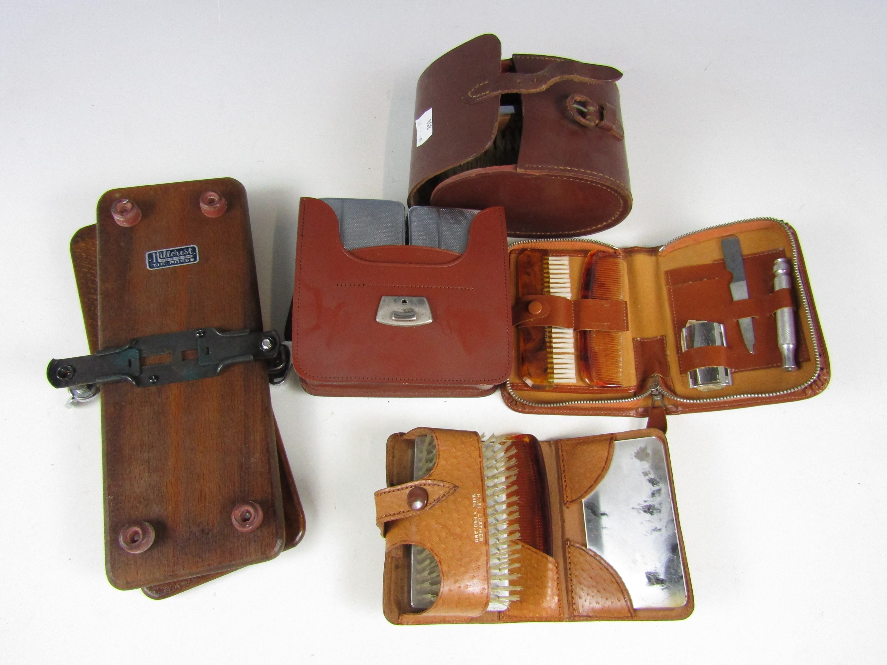 Lot 45 - A quantity of 1930s-1940's gentlemen's leather-cased grooming sets and a tie press