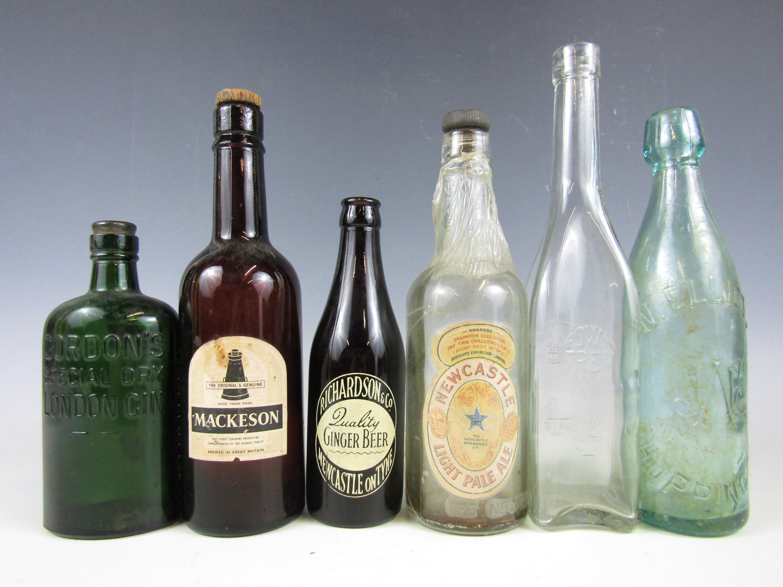 Lot 59 - Six vintage glass bottles including Mackeson Stout, Newcastle Light Ale and Richardson's Newcastle