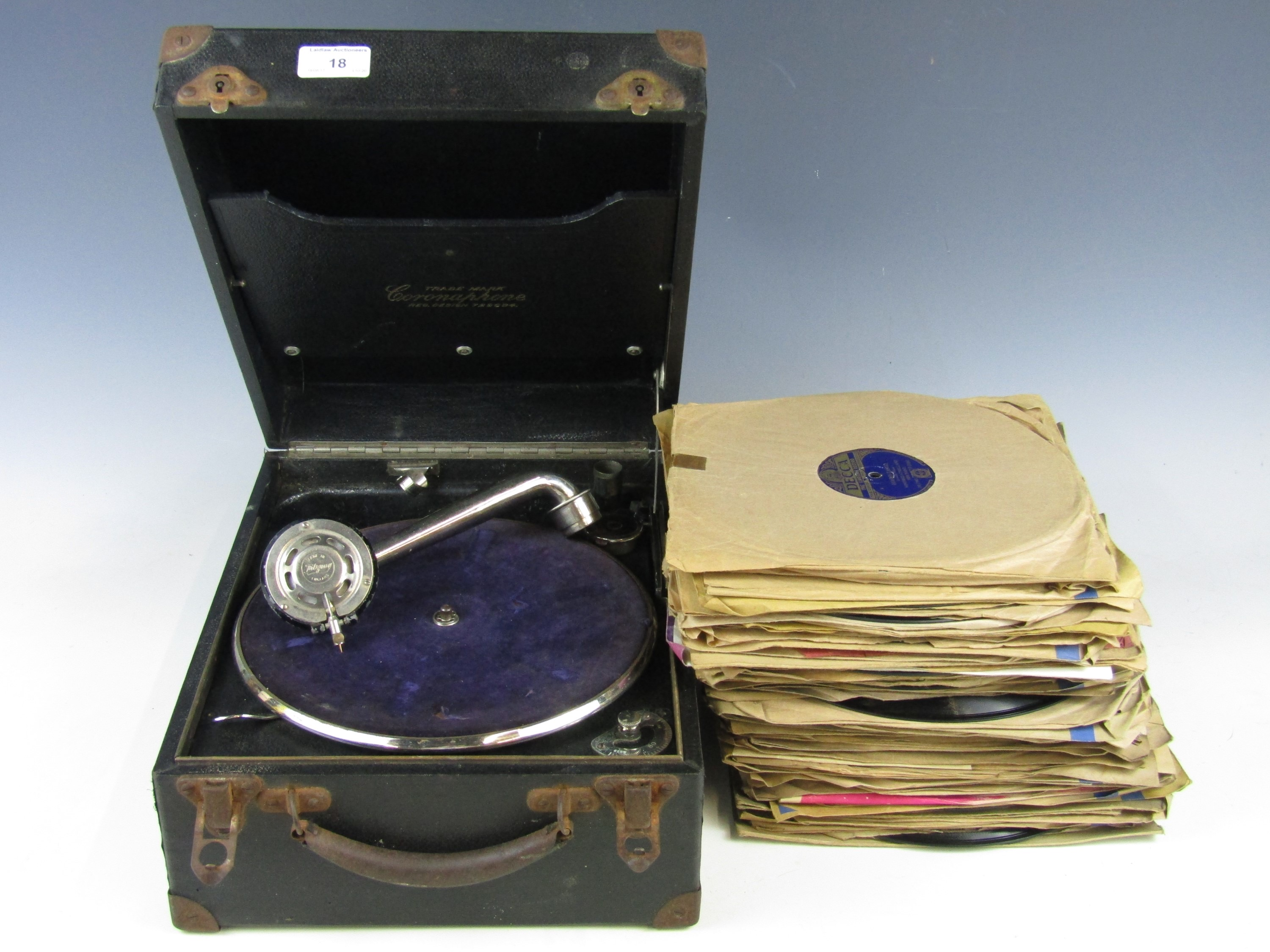 Lot 18 - A vintage portable gramophone with a quantity of records