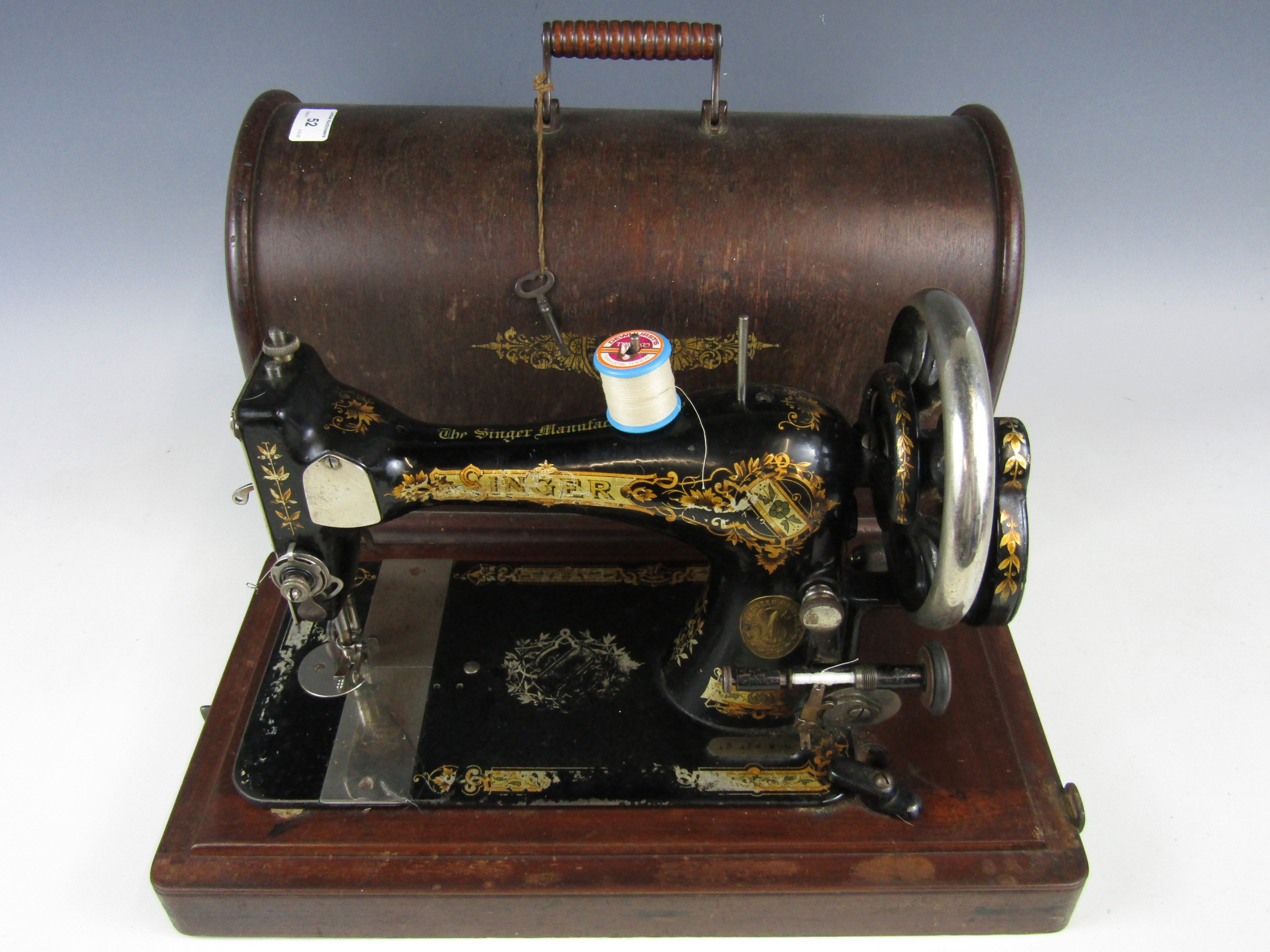 Lot 46 - A late 19th / early 20th Century Singer hand operated sewing machine