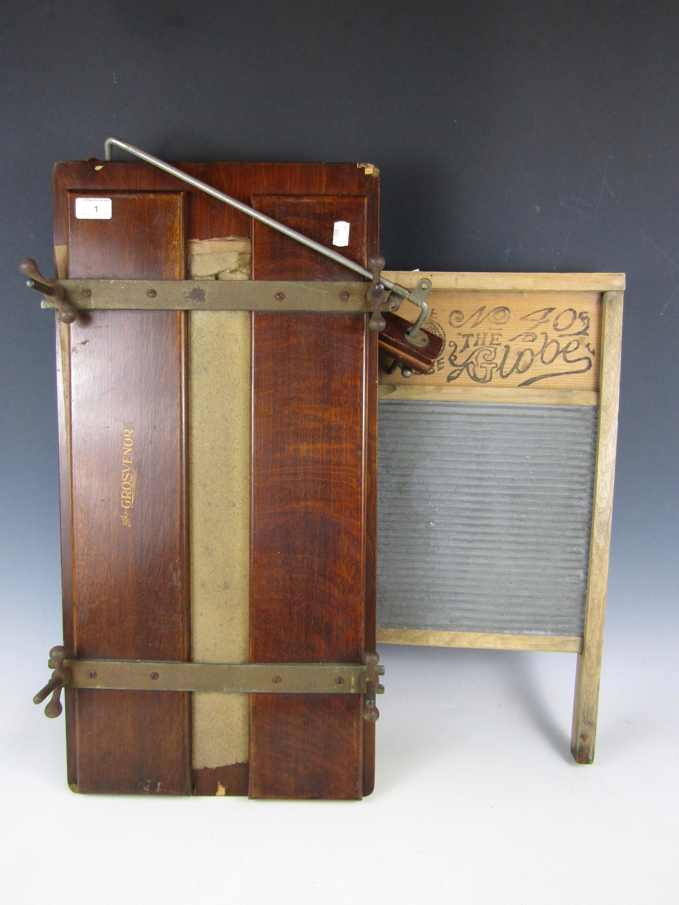 Lot 1 - An early 20th Century 'The Grosvenor' wooden trouser press together with a Globe No. 405 washboard