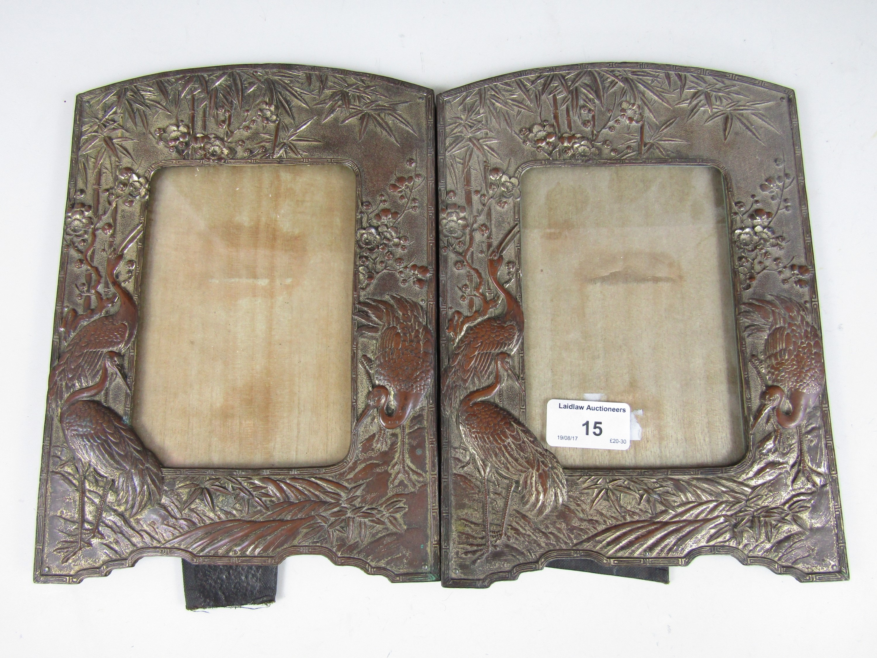 Lot 15 - A pair of early 20th Century Japonisme electroplate photograph frames