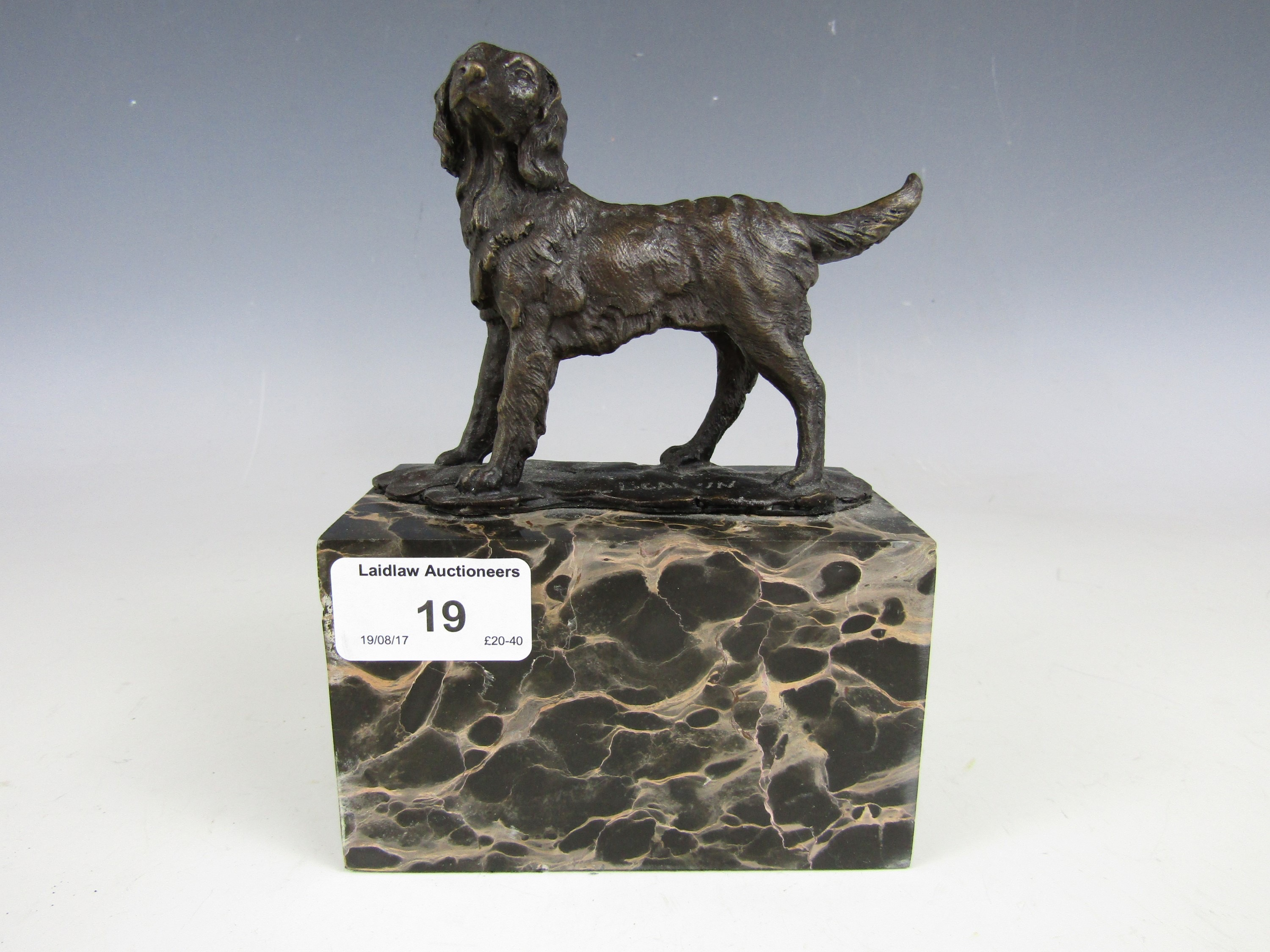 Lot 19 - A contemporary cold cast bronzed dog on marbled plinth, signed 'L. Garin'