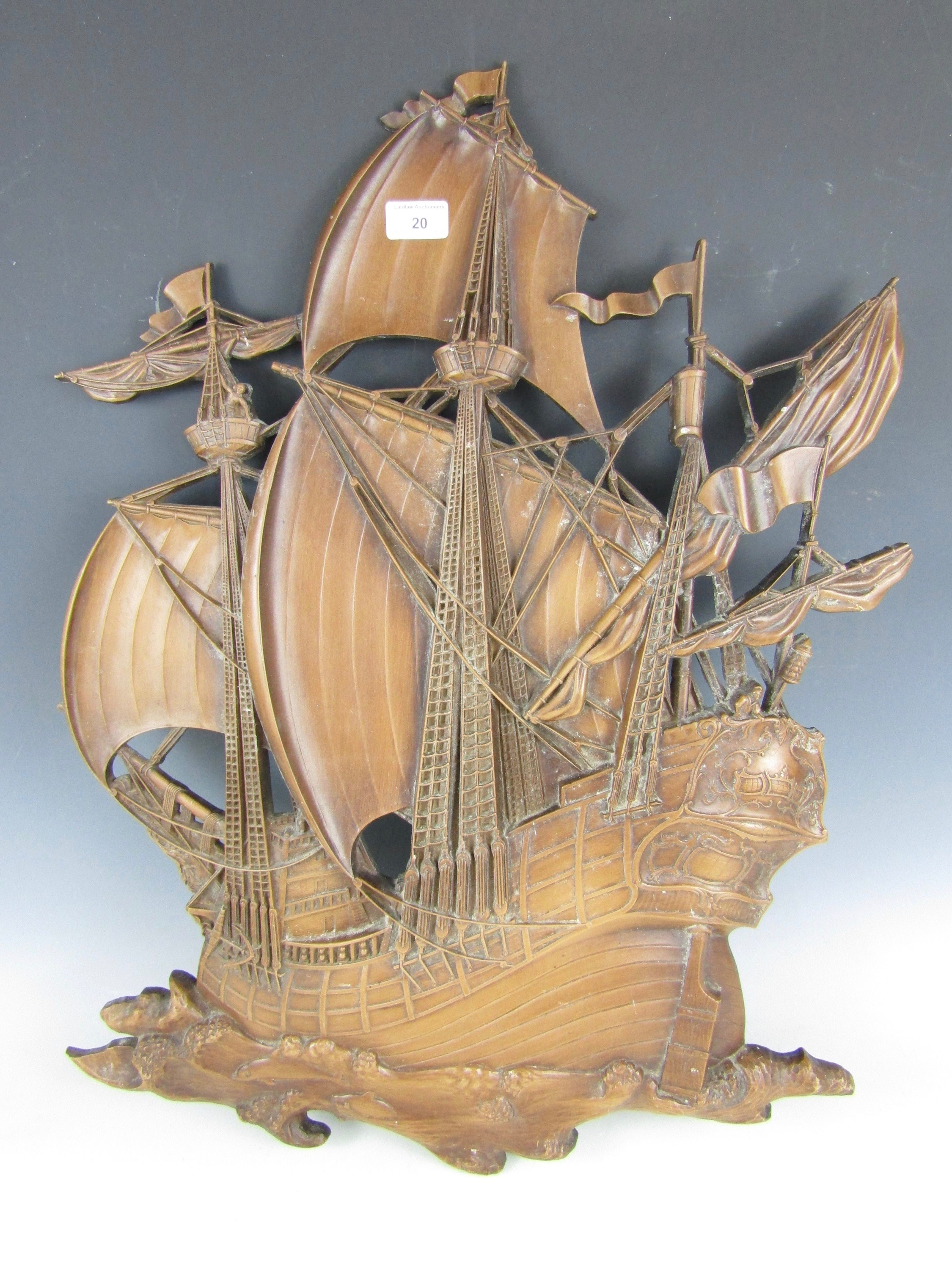 Lot 20 - A vintage moulded resin wall plaque modelled as a galleon, 73 cm