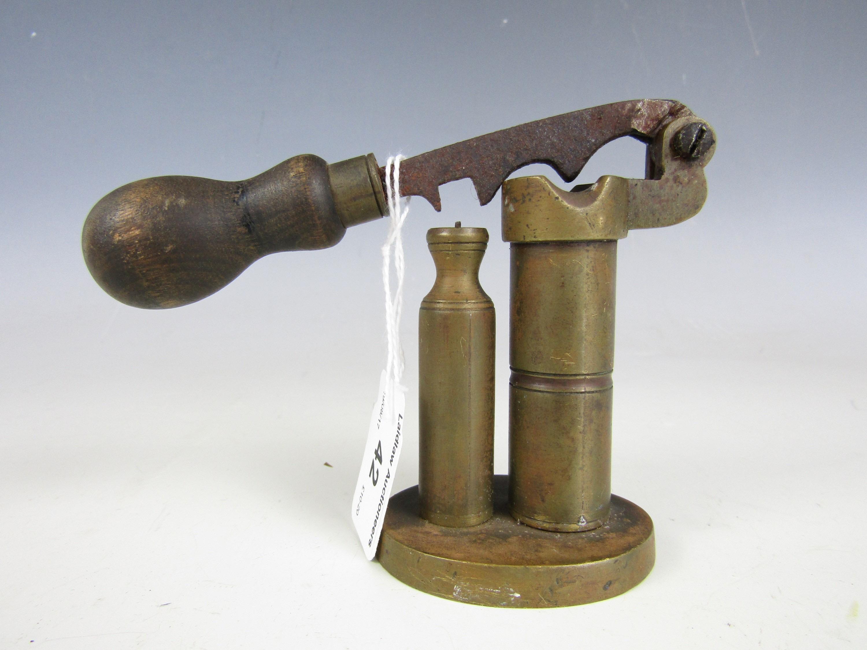 Lot 42 - An antique brass shot gun cartridge capping / de-capping tool