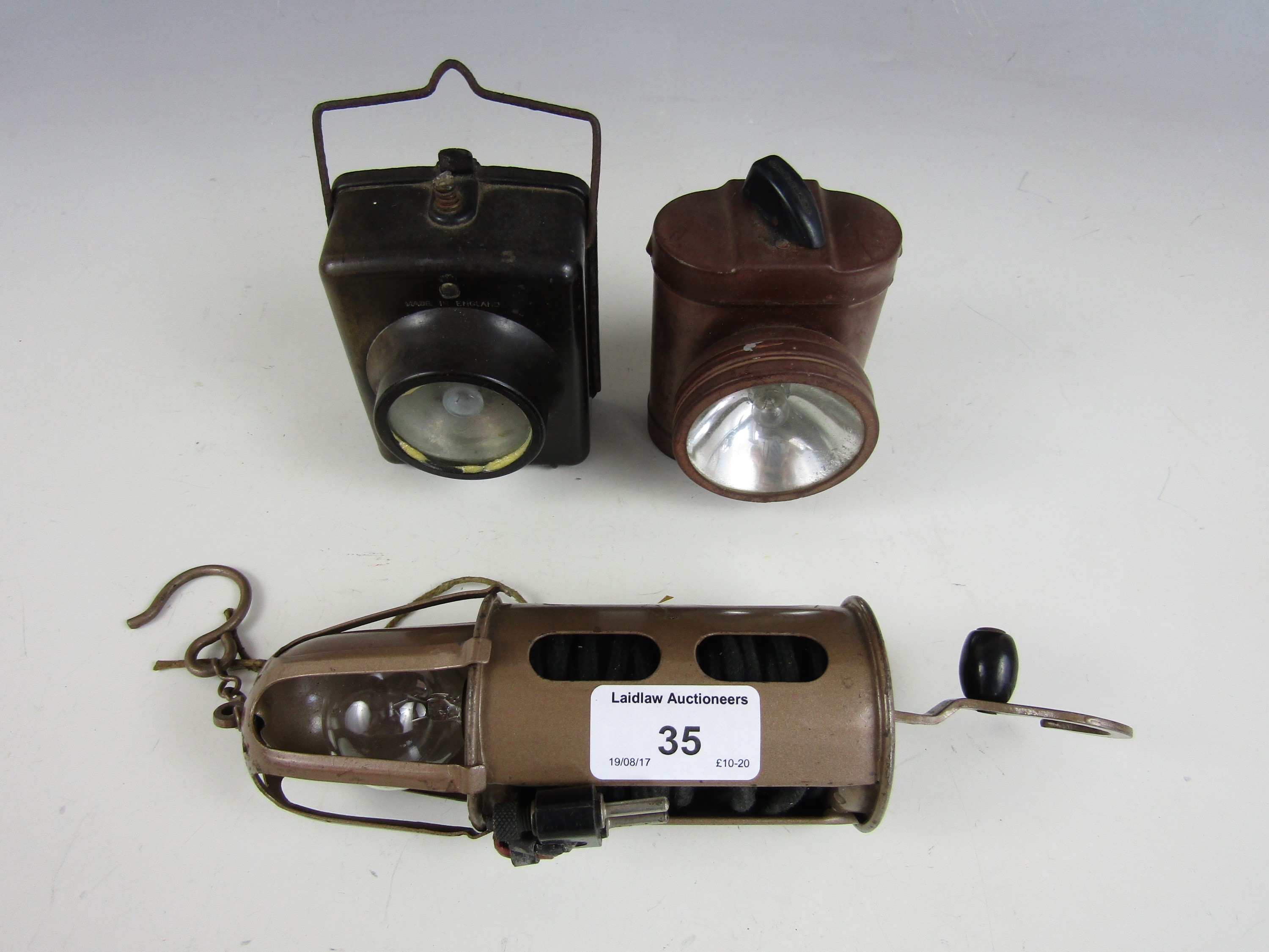 Lot 35 - An RAF / Air Ministry inspection lamp and two vintage torches