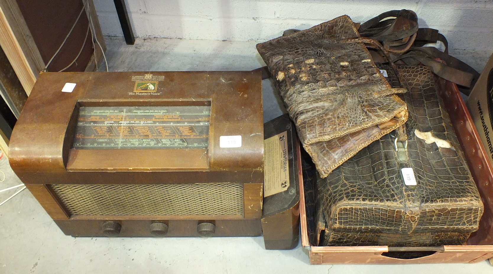 Lot 119 - An HMV model No.1120 wooden-cased vintage valve radio, (a/f), a reptile skin Gladstone bag, (a/f)