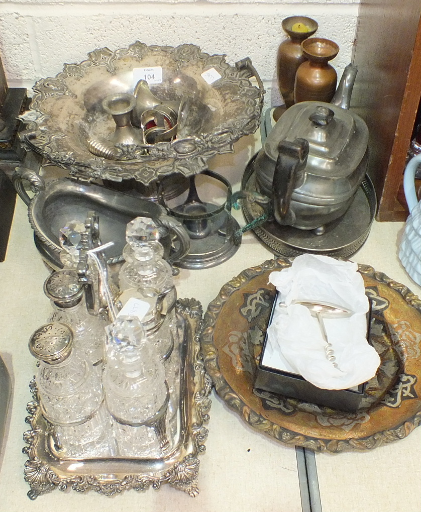 Lot 104 - A six-division plated cruet stand containing six cut-glass bottles, 21cm high and other plated and
