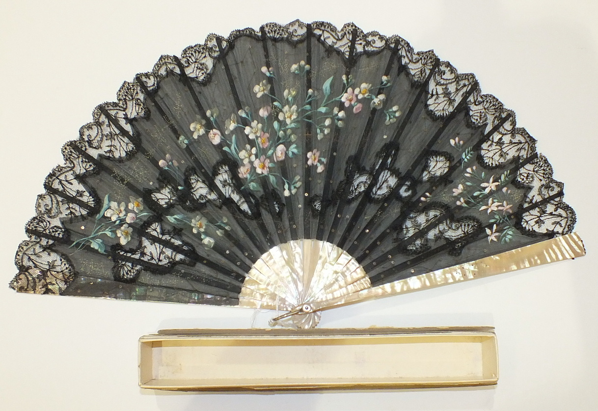 Lot 238 - A 19th century fan with mother-of-pearl guards, (repaired) and sticks and painted black gauze leaf