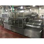 2009 G. Mondini tray sealer, model EVO 4X, s/n 3674/09, 4 wide, with carts and dies. With SS control