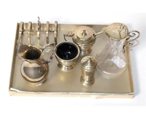An unusual silver mounted whisky noggin, Birmingham 1903; a toast rack; a condiment set; and a cream jug, weighable silver ap