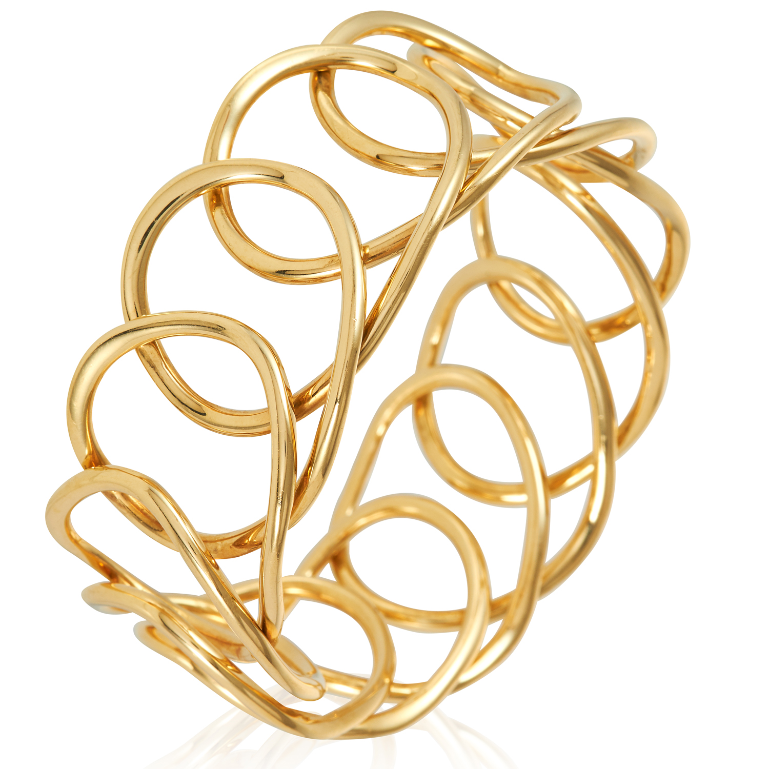 A FANCY LINK GOLD BANGLE in 18ct yellow gold, designed as a woven loop overlapping itself, British