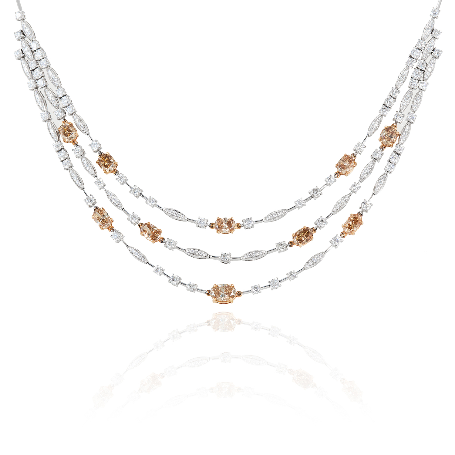 A 10.90 CARAT DIAMOND NECKLACE in 18ct white gold, designed as a trio of rows of white diamond