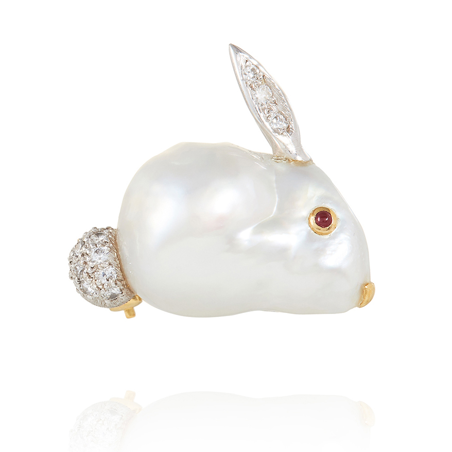 A BAROQUE PEARL, RUBY AND DIAMOND BUNNY RABBIT BROOCH, E WOLFE & CO in high carat gold, designed