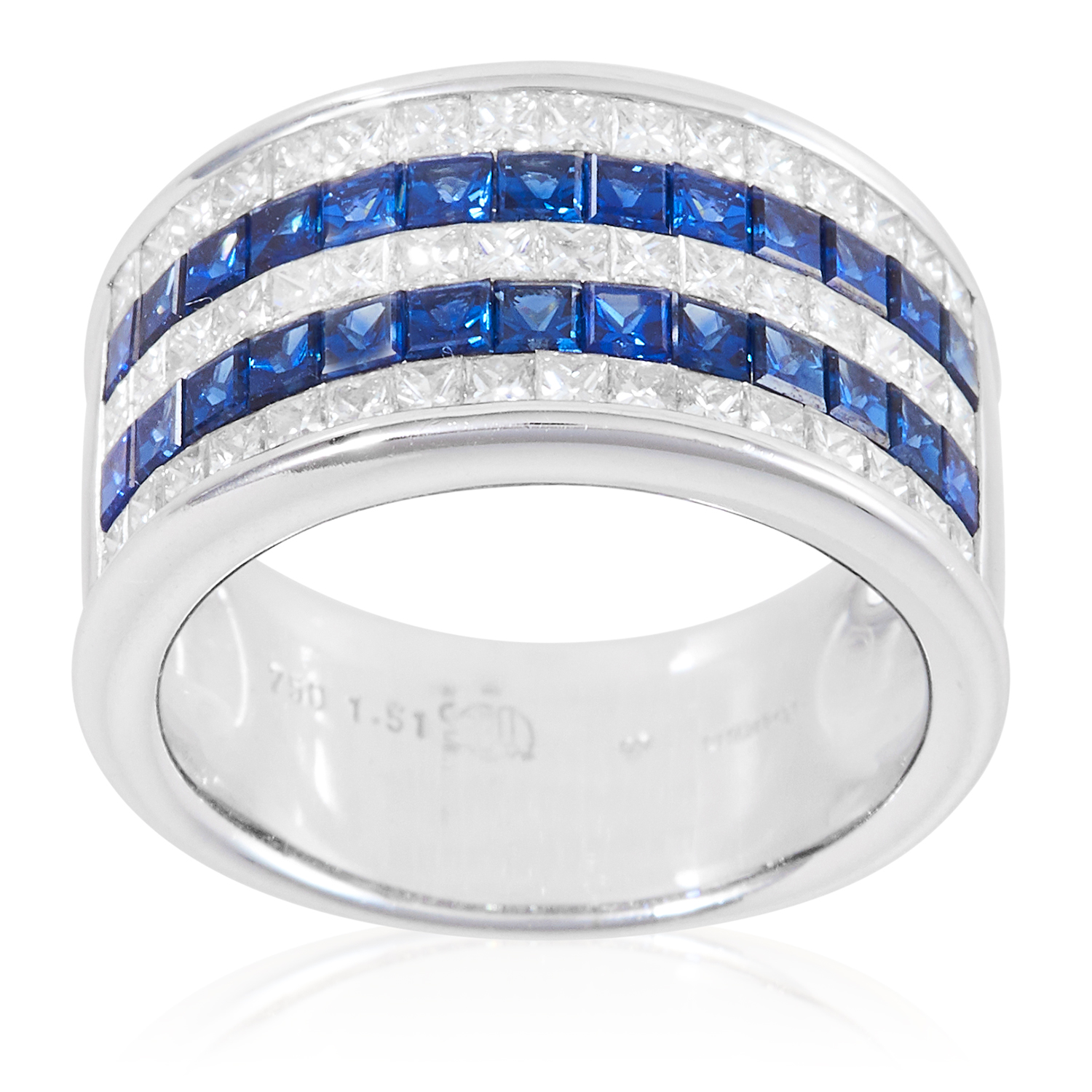 A SAPPHIRE AND DIAMOND HALF ETERNITY RING in 18ct white gold, comprising five rows of alternating