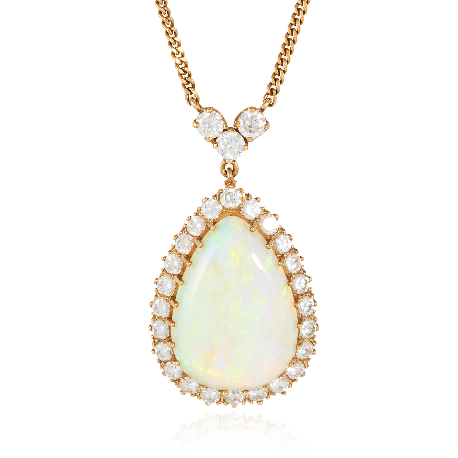 AN OPAL AND DIAMOND PENDANT NECKLACE in 18ct yellow gold, the large pear shaped cabochon encircled