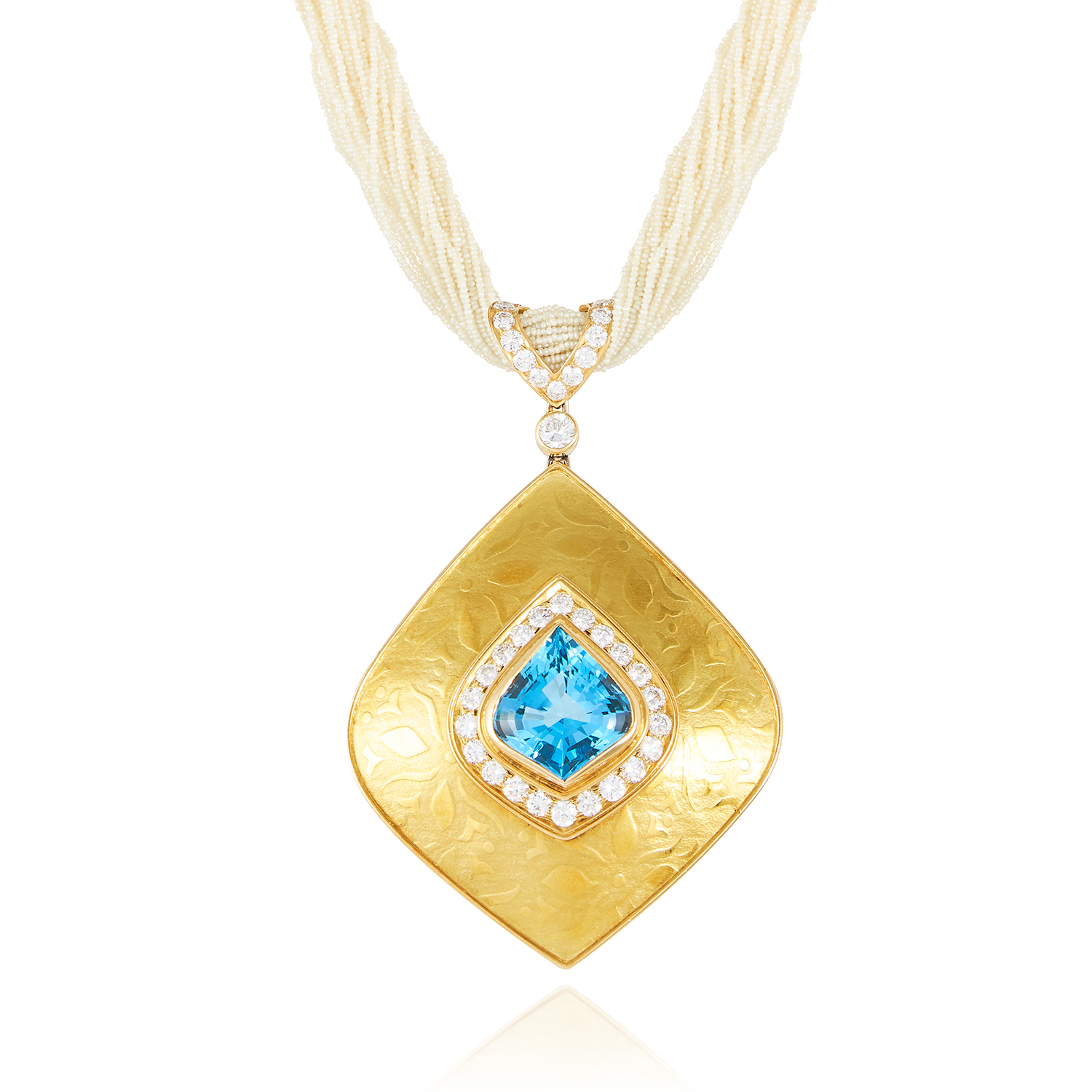 A TOPAZ, DIAMOND AND SEED PEARL PENDANT NECKLACE in 18ct yellow gold, the fancy kite shaped blue