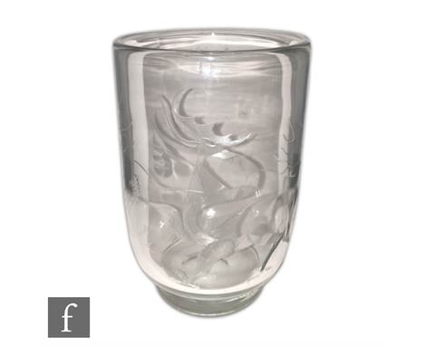 Steuben - A large 1930s Art Deco clear crystal vase of footed cylindrical form engraved decorated with a stylised dragon afte