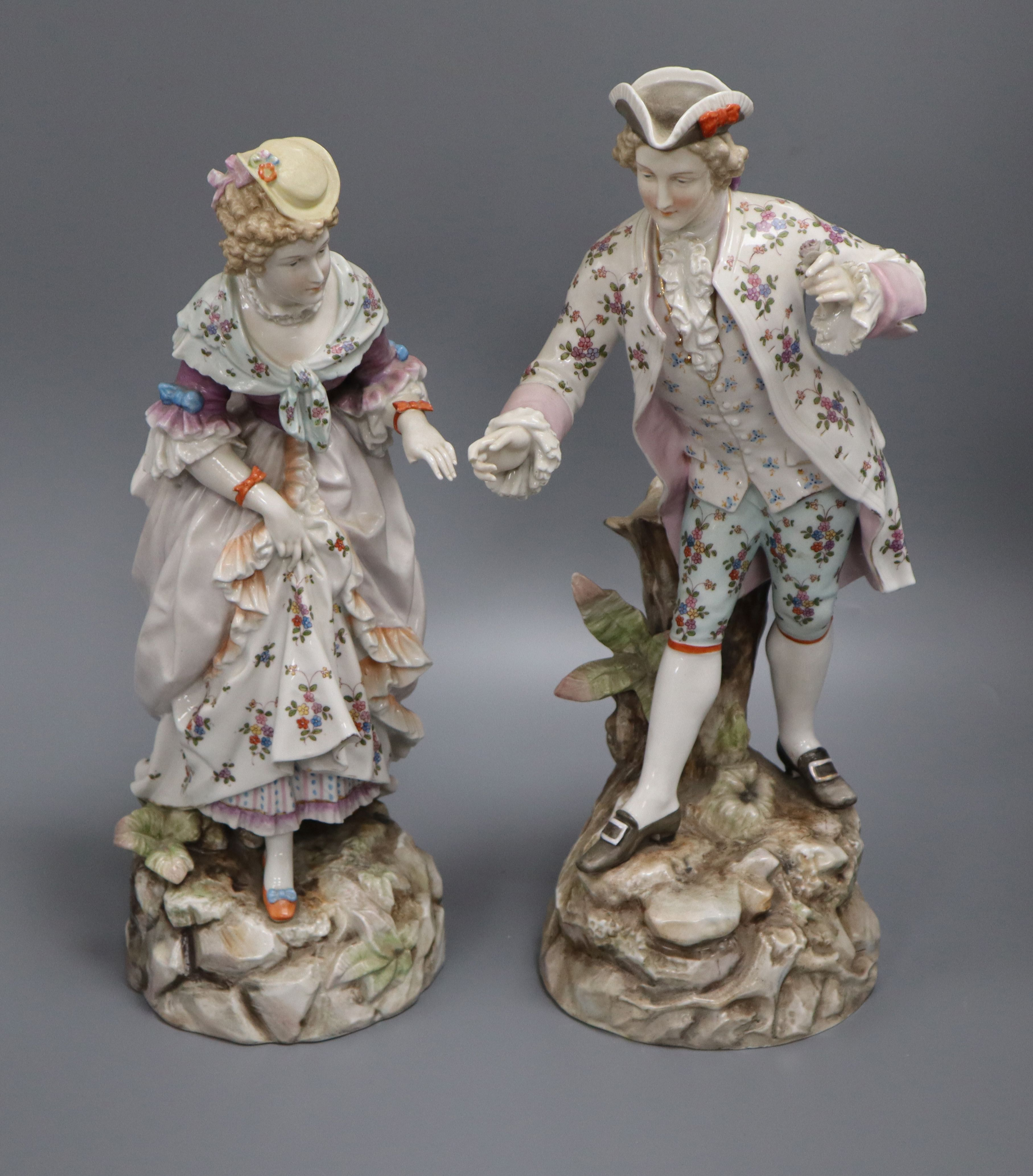 A pair of Rudolstedt Volkstedt porcelain figures height 37cm