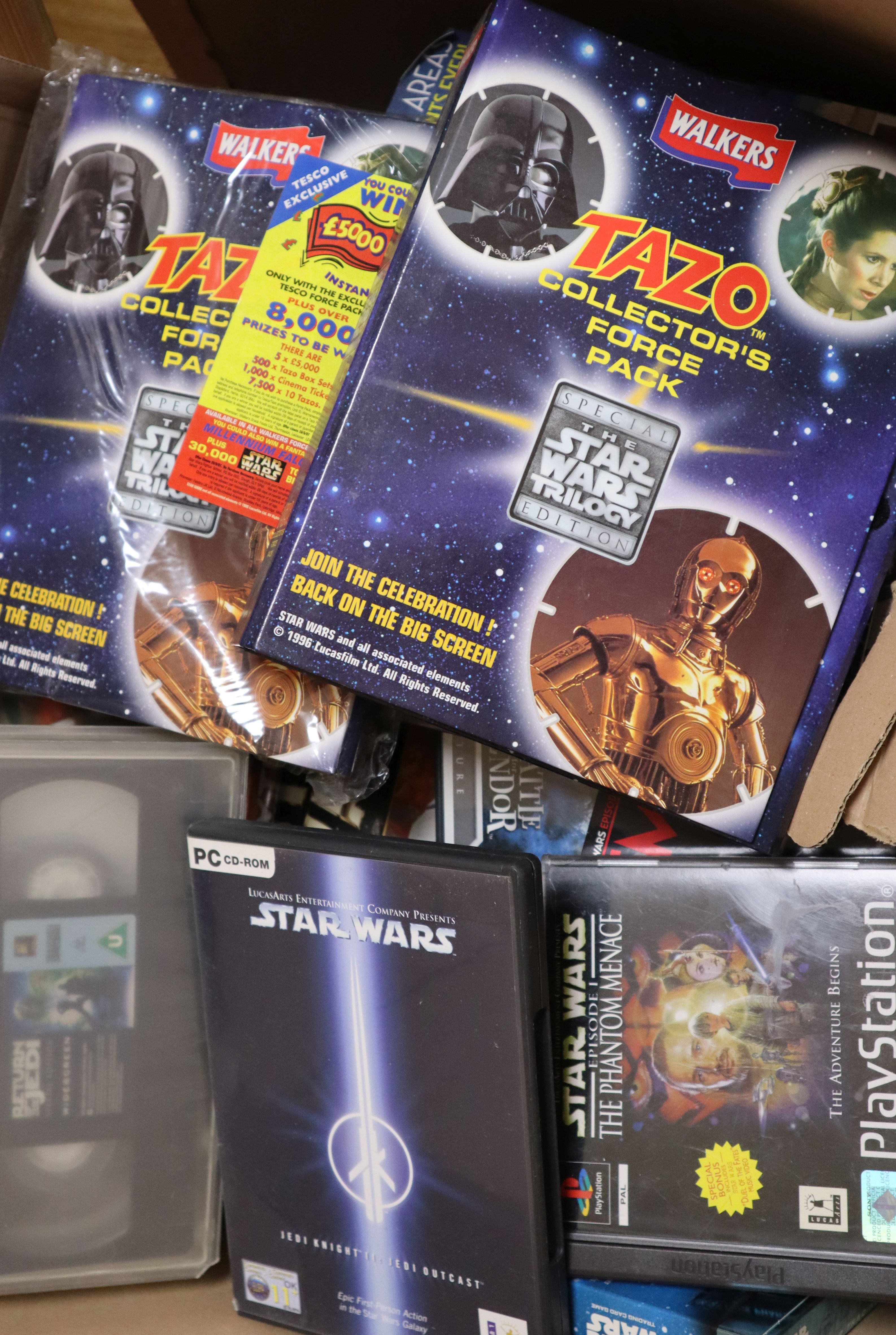Lot 17 - A collection of vintage Star Wars VHS tapes, DVDs, PC/console games etc. see Gorringes website