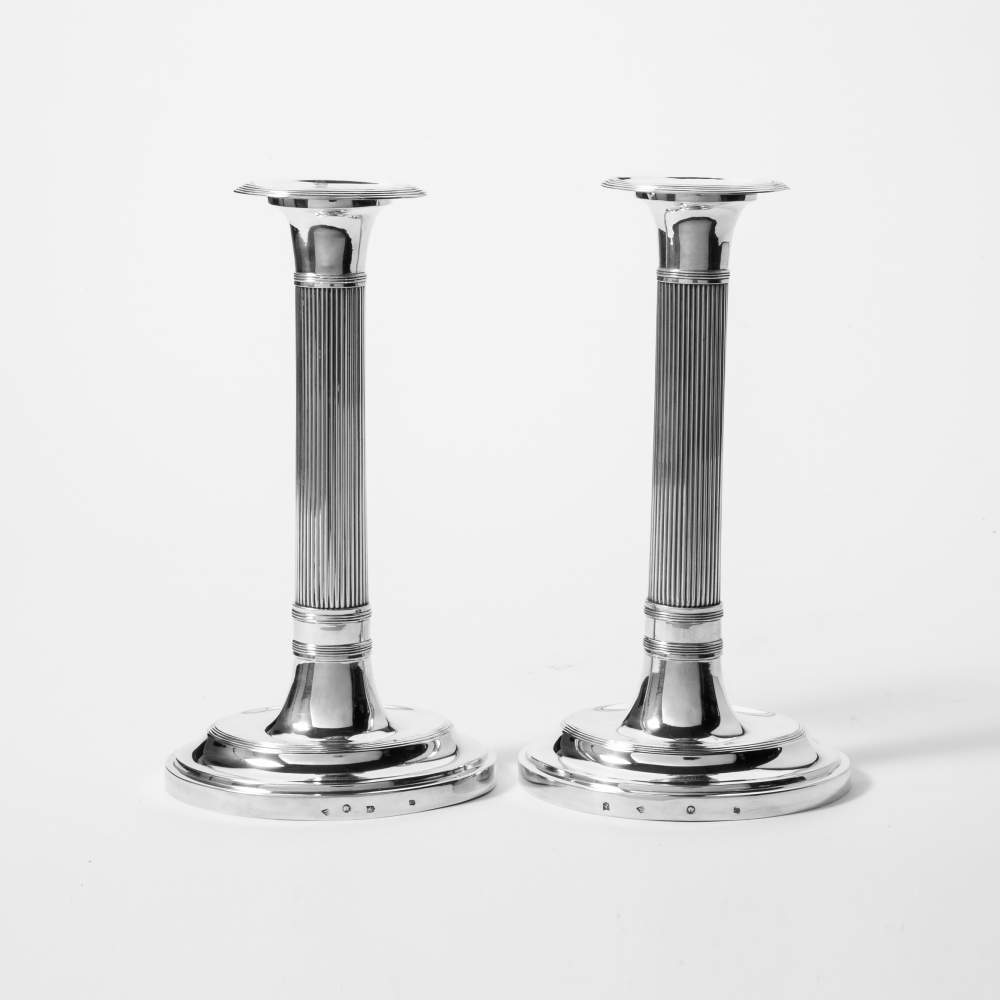 Lot 36 - A pair of silver empire candlesticks Nicolaas van Voorst, Utrecht, 1818 Ribbed shaft, oval foot.