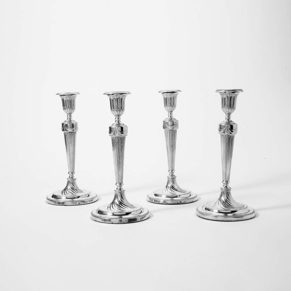 Lot 37 - A series of four silver George III candlesticks Sheffield, 1782, John Winter & Company Tapering