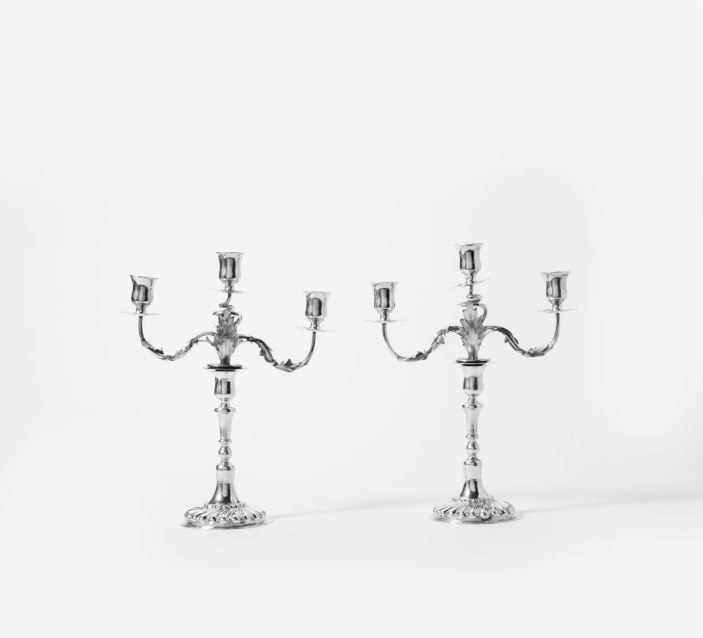 Lot 33 - A pair of silver candlesticks 'à double usage' Circa 1770, possibly  Baltic, maker's mark GB The