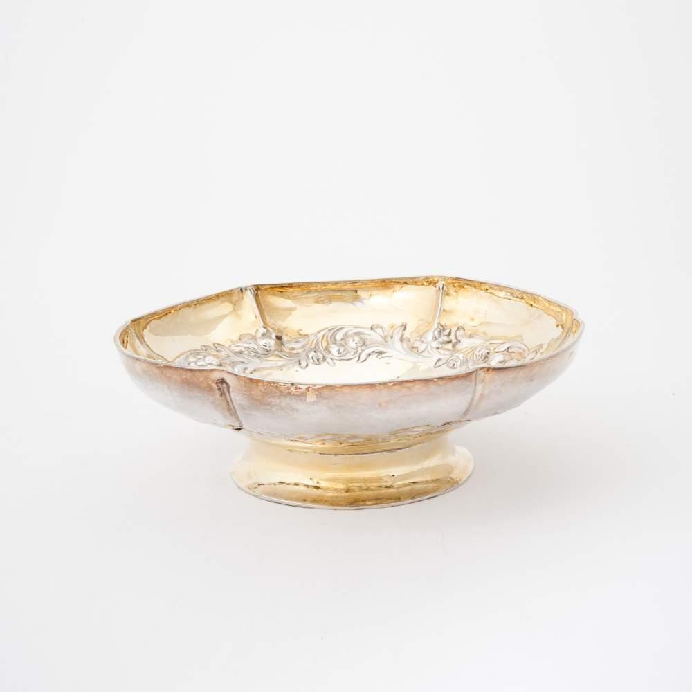 Lot 59 - A lobed gilt silver alms dish Amsterdam, circa 1700, Adriaen Doeff With a raised decoration of a