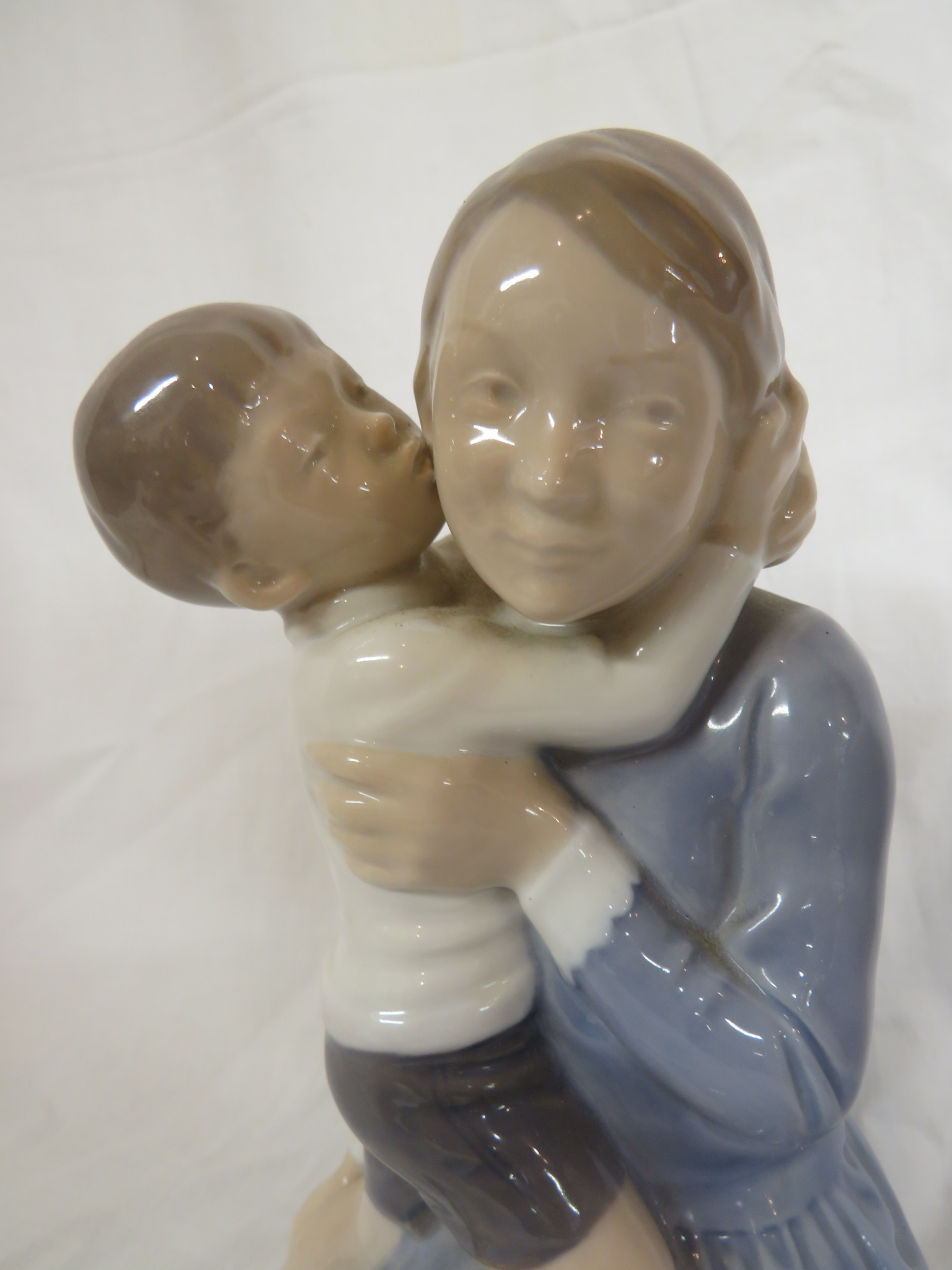 Lot 75 - Royal Copenhagen porcelain figural group of mother and child, number 3457, impressed initials FC,