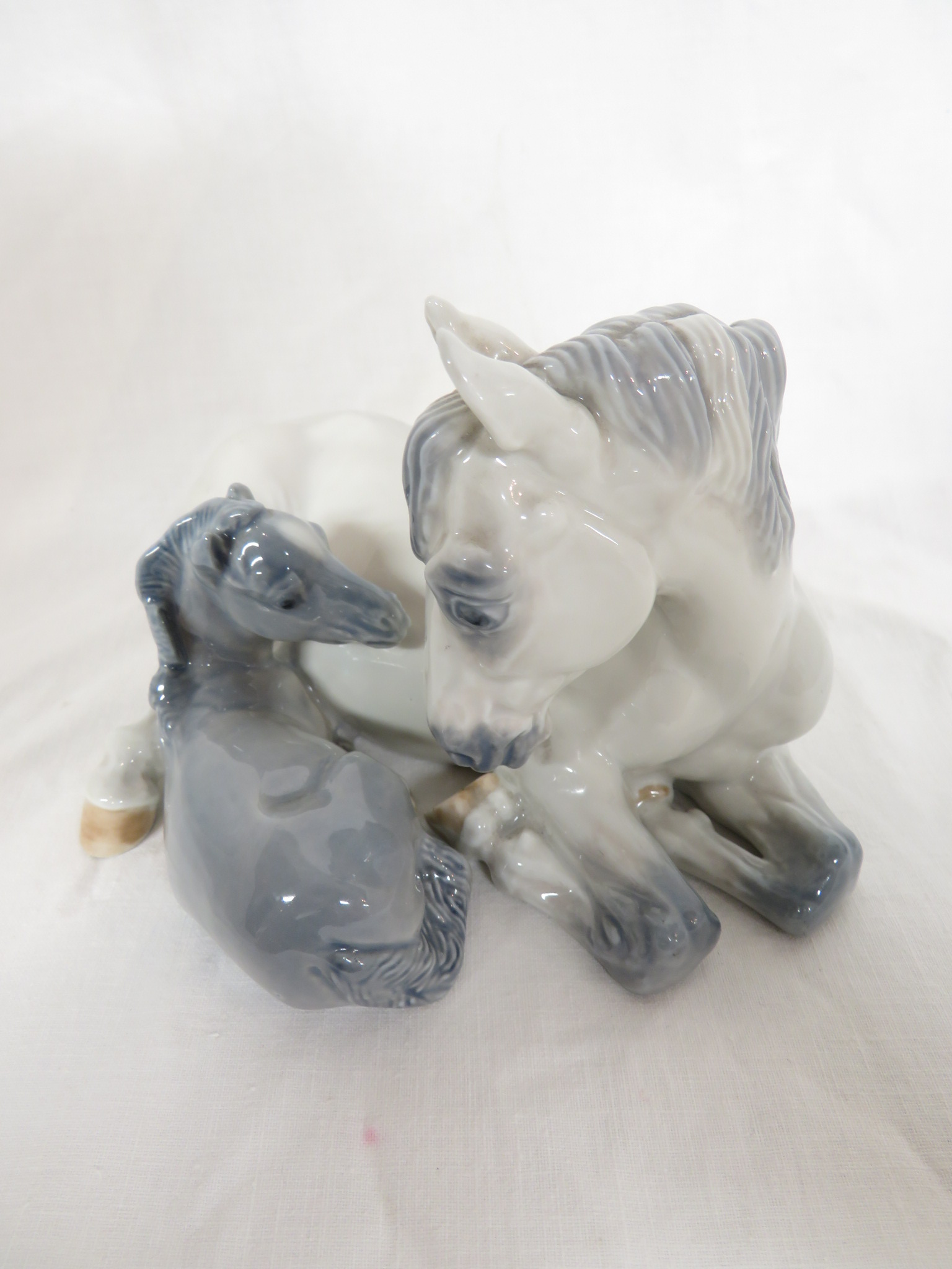 Lot 79 - Royal Copenhagen porcelain figural group of mare and foal, numbered 4698, (length 18cm, height