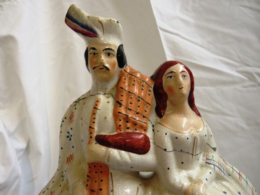 Lot 110 - Six Staffordshire pottery figures and animals - flatback kilted couple with clock (height 36cm),