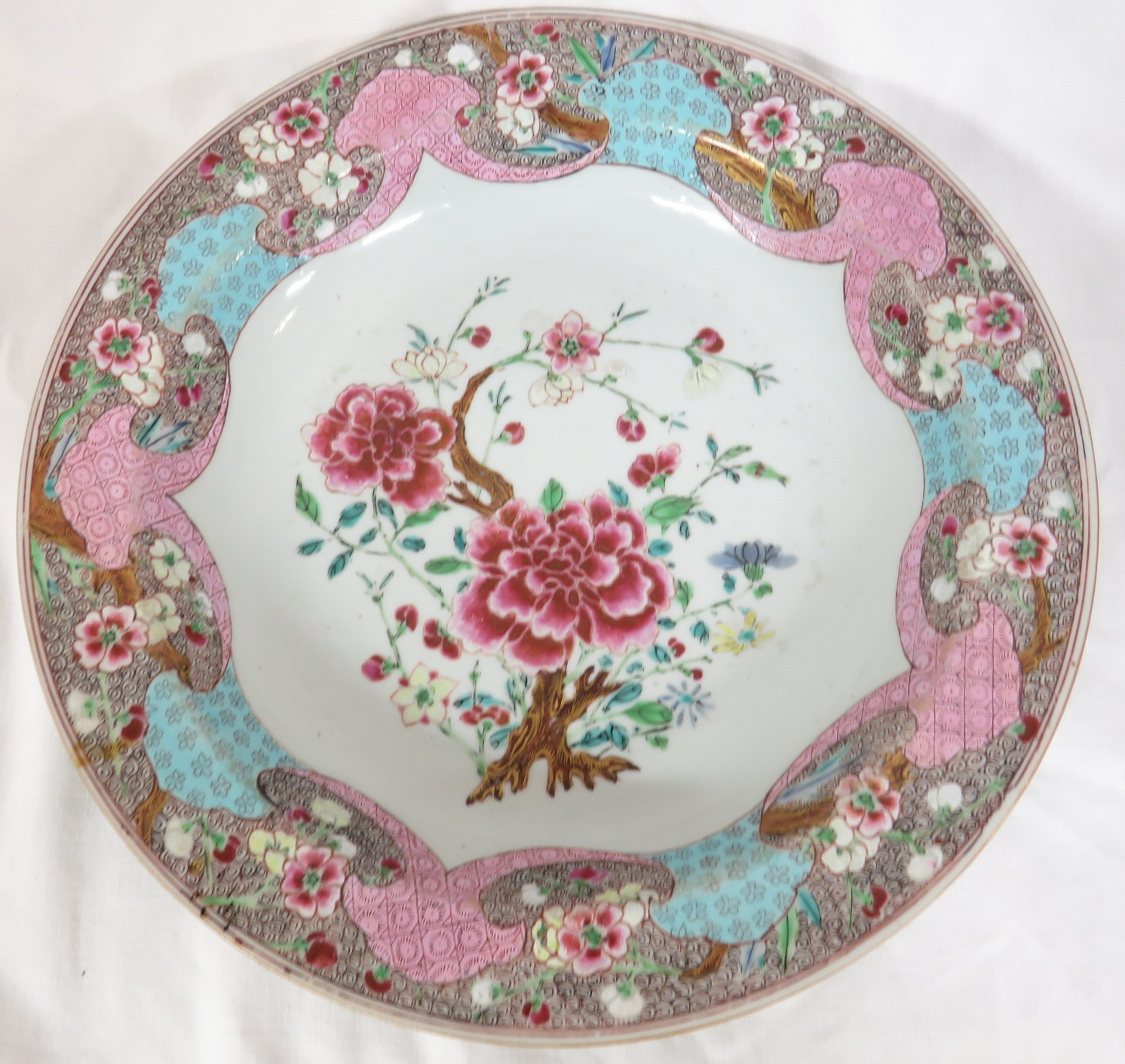 Lot 100 - Chinese porcelain famille rose dish, the central reserve enamelled with flowering branch, the border
