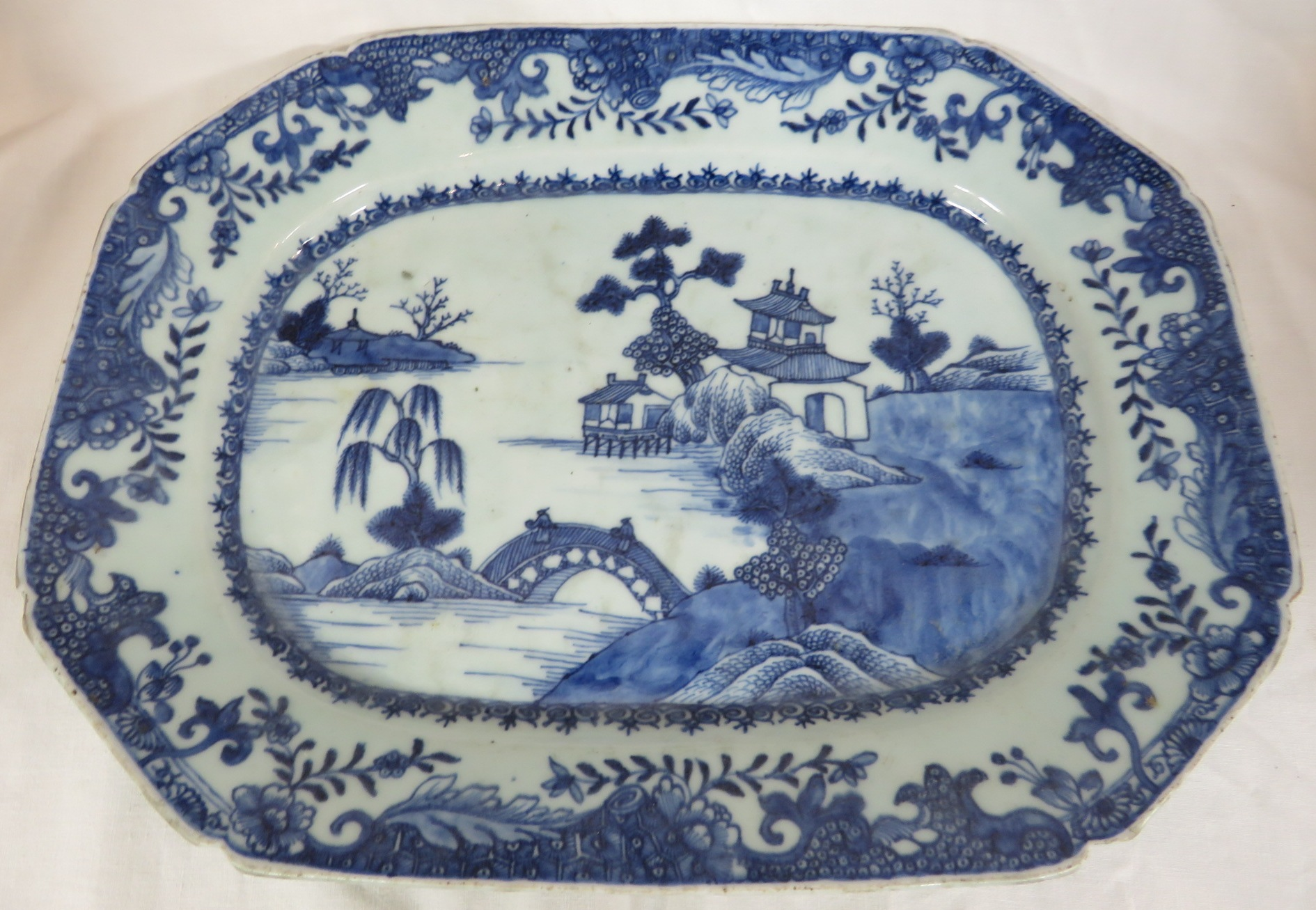 Lot 107 - A porcelain dish or charger of octagonal oblong shape, decorated in underglaze blue in the Chinese