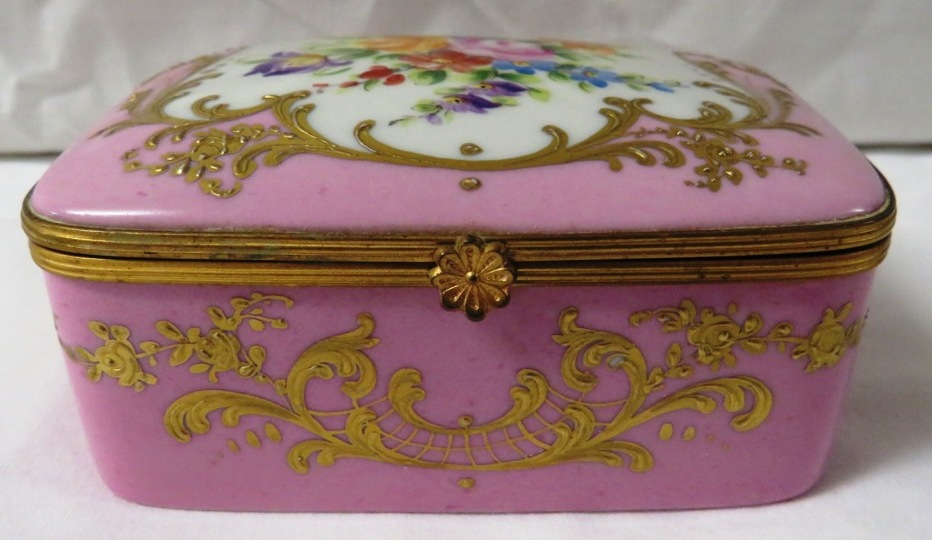 Lot 67 - Le Tallec porcelain box with hinged lid, pink ground with gilded scrolled foliage, the lid and