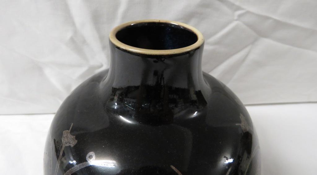 Lot 82 - Royal Copenhagen ovoid porcelain vase in a near black glaze with metallic decoration of birds