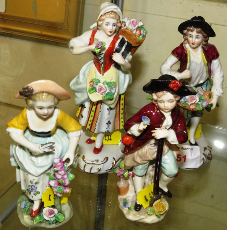 Lot 65 - Two pairs of Sitzendorf porcelain figures - flower sellers (14cm) and gardeners (11cm)