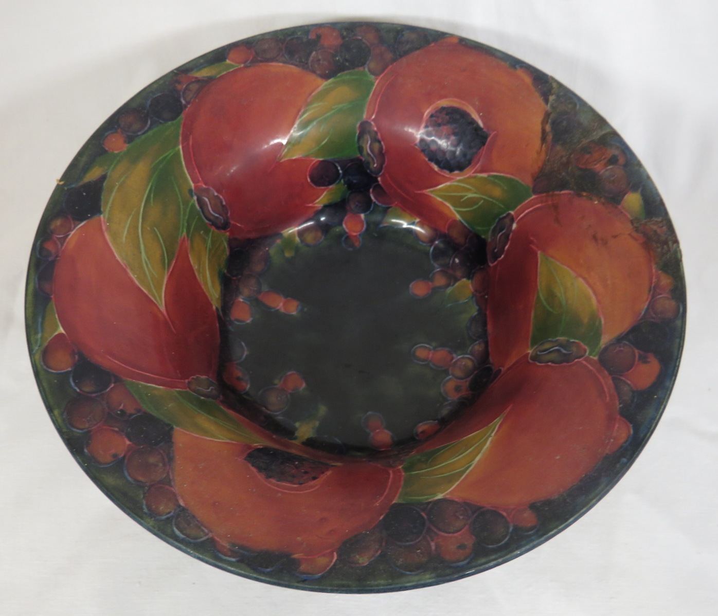 Lot 91 - Moorcroft pomegranate bowl, height 8cm diameter 21cm, signature to base and stamped MOORCROFT