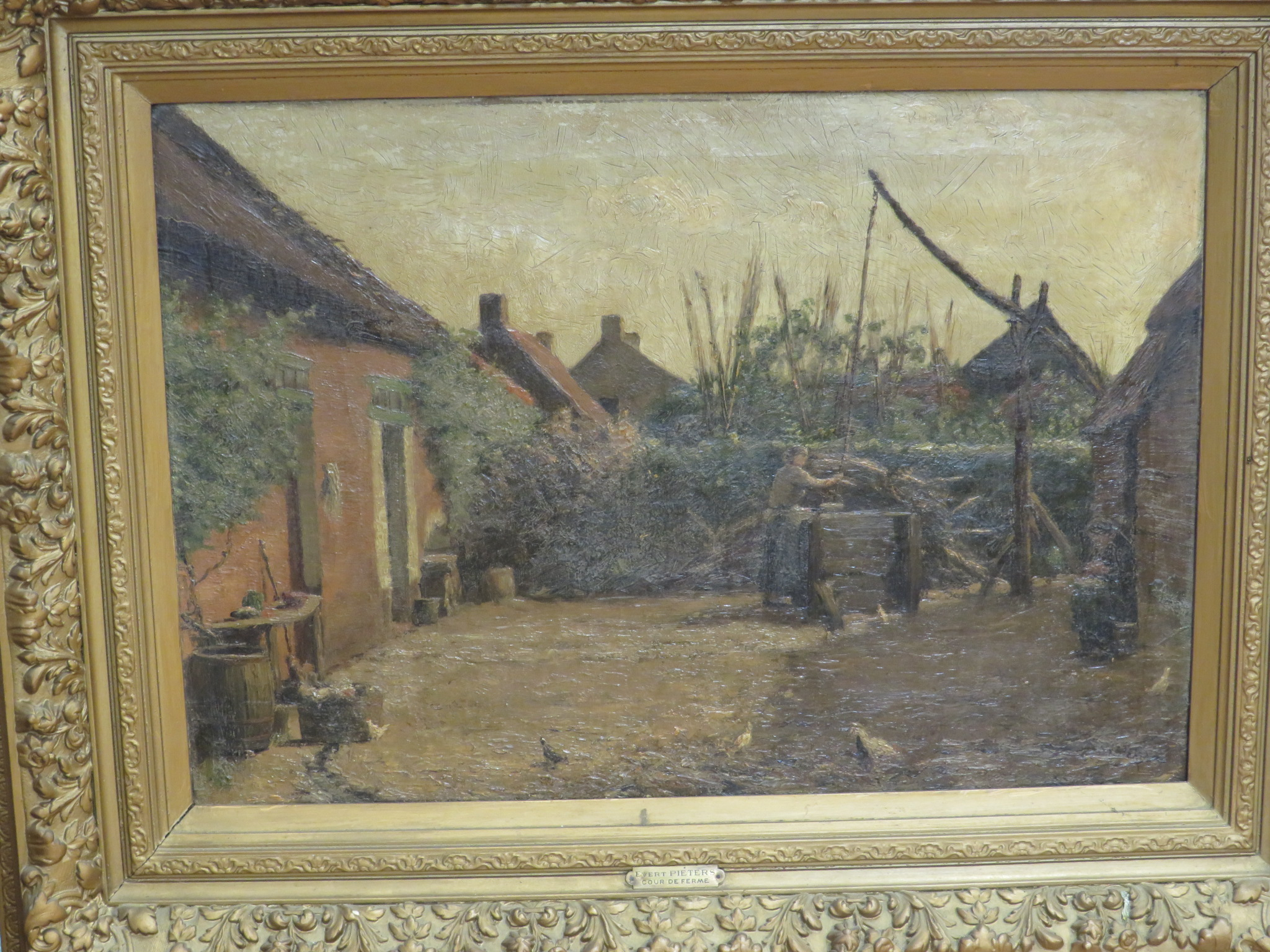 Lot 1 - 'Cour de Ferme', oil on canvas, signed lower right (42.5cm x 62cm), in a moulded gilt gesso frame,