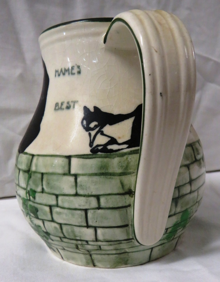 Lot 66 - Royal Doulton H Souter jug decorated with four black and white cats on a wall grown with ivy and