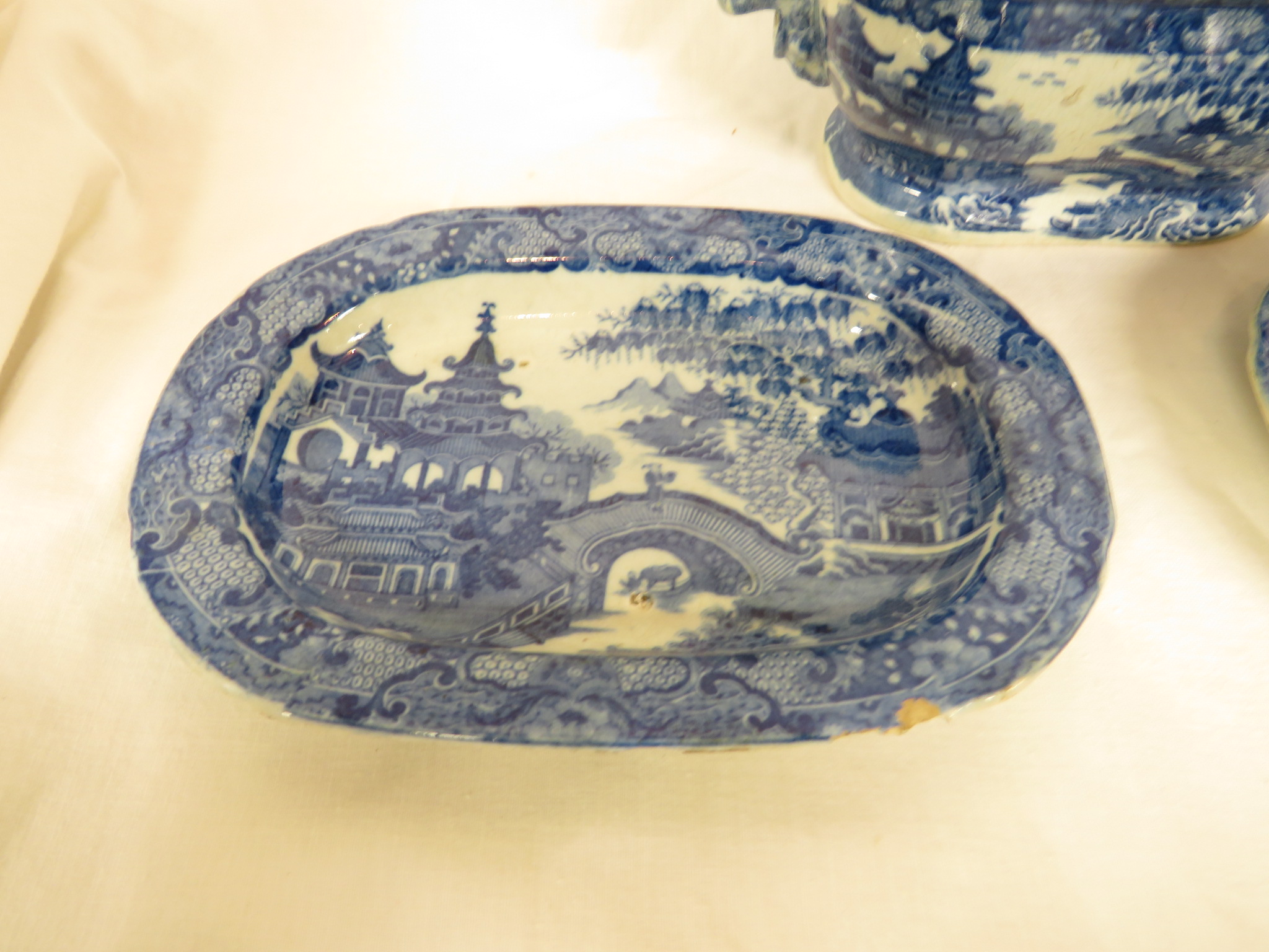 Lot 86 - 19th century pottery sauce tureen and ladle with two oblong dishes transfer decorated in blue and