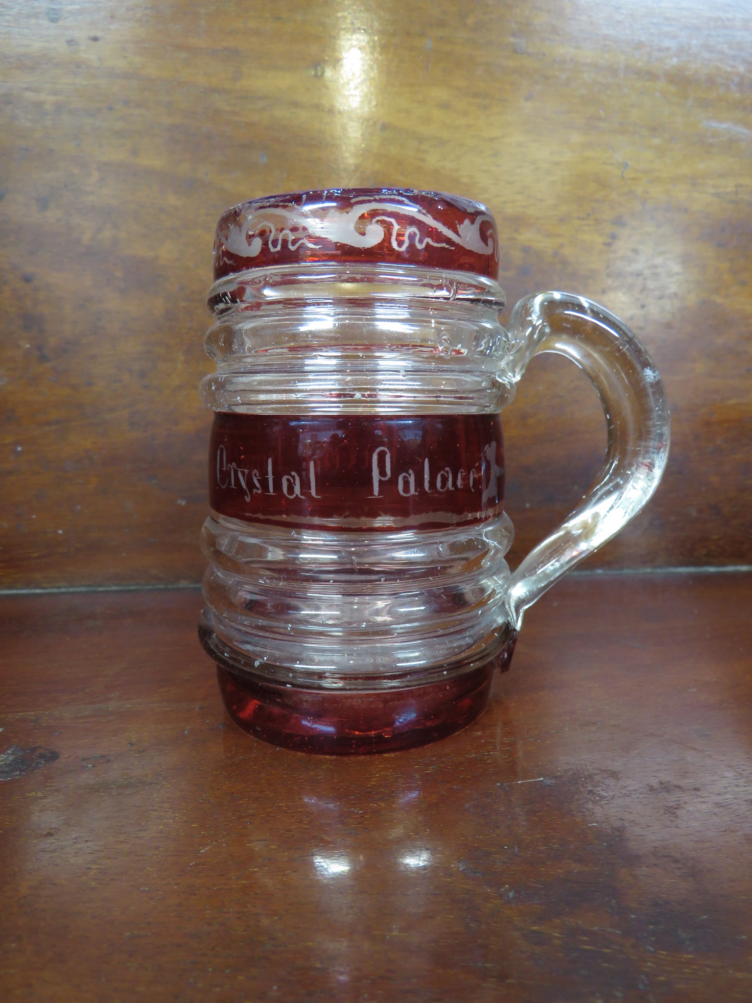 Lot 122 - Hand blown glass tankard with inscription 'A Present from Crystal Palace', height 10.5cm