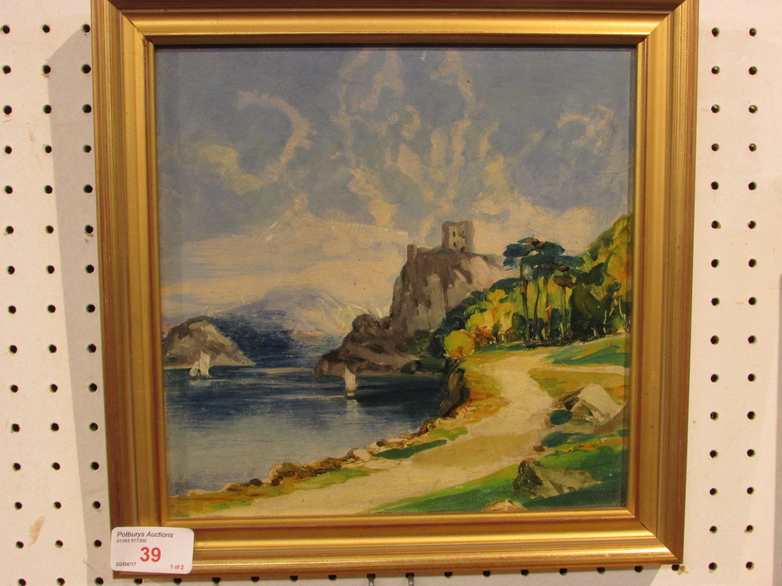 Lot 39 - Two oil on board landscapes - bridge with mountain beyond, and castle on cliff by coast, each 22cm x