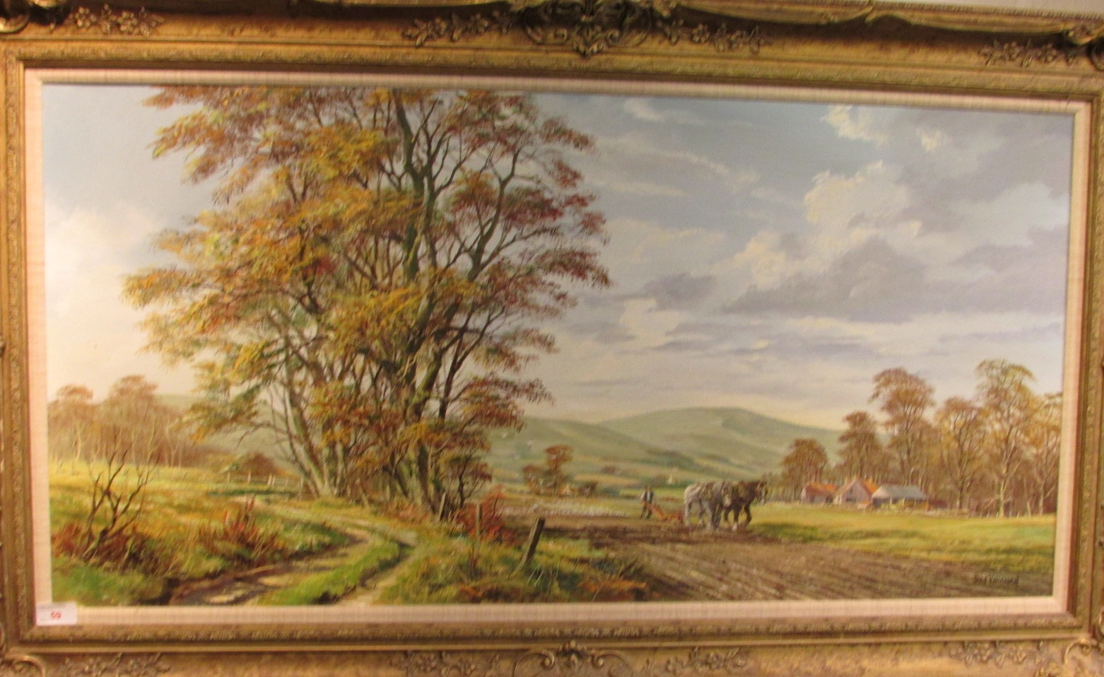 Lot 59 - 'Ploughing in Sussex', oil on canvas, signed Don Vaughan lower right, (49cm x 100cm) in a moulded